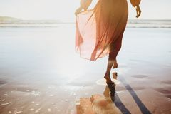 Young woman running on seaside path. stock photos