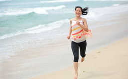 Young woman running seaside Royalty Free Stock Photography