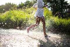 Young woman running in shallow water Stock Image