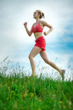 Young woman running summer park rural road Royalty Free Stock Images