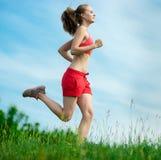 Young woman running summer park rural road Royalty Free Stock Photos