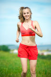 Young woman running summer park rural road Royalty Free Stock Photography