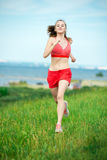 Young woman running summer park rural road Royalty Free Stock Photos