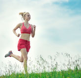 Young woman running summer park rural road Stock Image