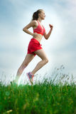 Young woman running summer park rural road Royalty Free Stock Image
