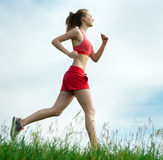 Young woman running summer park rural road. Outdoor exercises. J Stock Photos