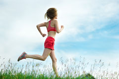 Young woman running summer park rural road. Outdoor exercises. J Stock Image