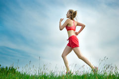 Young woman running summer park rural road. Outdoor exercises. J Stock Images