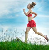 Young woman running summer park rural road. Outdoor exercises. J Royalty Free Stock Image