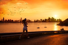 Young woman running at sunset Royalty Free Stock Photo