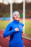 Young woman running at a track Royalty Free Stock Photo