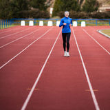 Young woman running at a track Royalty Free Stock Photography