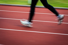 Young woman running at a track Stock Image