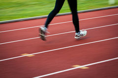 Young woman running at a track Royalty Free Stock Photos