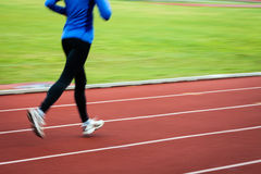 Young woman running at a track Royalty Free Stock Images
