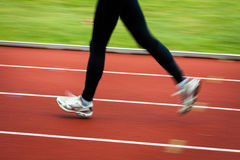 Young woman running at a track Stock Photos