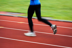 Young woman running at a track Stock Photo