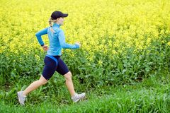 Young woman running on trail Royalty Free Stock Photos