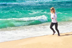 Young Woman Running Training Sport on Beach Seasid Stock Images