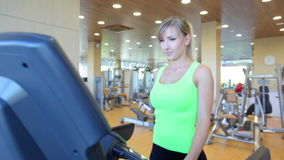 Young woman running on treadmill stock footage