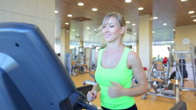 Young woman running on treadmill.  stock video