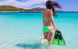 Young woman running into tropical blue sea with Royalty Free Stock Images