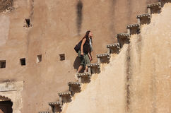 Young woman running up the stairs, Bundi Palace, India Stock Images