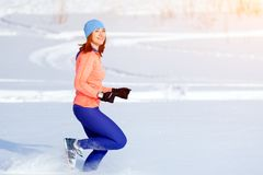 A young woman running winter stock photo
