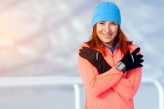 A young woman running winter royalty free stock photos