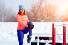 A young woman running winter royalty free stock photography