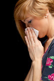 Young woman with a runny nose Stock Photography