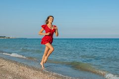Young woman runs on the Beach Stock Photography