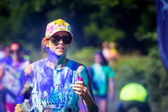 Young woman runs the Color Vibe 5K race Royalty Free Stock Images