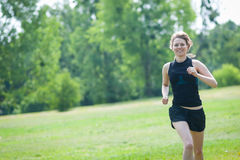 Young woman runs at park Royalty Free Stock Photography