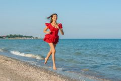 Young woman runs on the sea Royalty Free Stock Photography