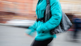 Young woman at rush hour walking in the street Stock Photography