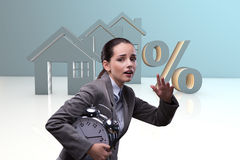 The young woman rushing to get best mortgage rates Stock Images