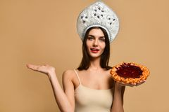 Portrait of a smiling woman holding pie royalty free stock photos