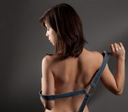 Young Woman's Back. An image of a young woman with a bare back except for straps Stock Images