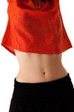 Young woman's belly, isolated, portrait. Photo of a fit young woman, with partially unclothed belly. Isolated, portrait orientation Royalty Free Stock Images