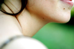 Young Woman's Chin. Closeup of a young woman's chin, lips and neck.  Shoulder is out of focus Stock Image