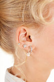 Young woman's ear Royalty Free Stock Image
