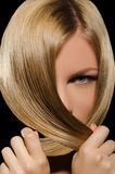 Young woman's face and beautiful straight hair Royalty Free Stock Photo