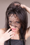 Young Woman's face with veil, Perfect makeup Royalty Free Stock Images