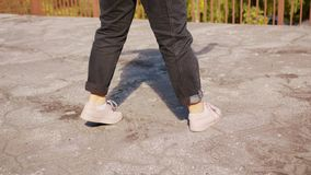 Young Woman`s Feet Dancing Outside royalty free stock photos