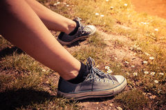 Young woman's feet outside on sunny day Stock Photo