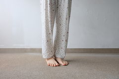 Young Woman's Feet with Plant On Floor or Ground Background. Great For Any Use Royalty Free Stock Image