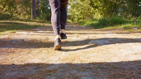 Young Woman`s Feet Running in the Forest stock photo
