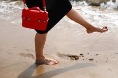 Foot on sandy beach stock photography