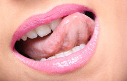 Young woman's glossy pink lips Stock Photo